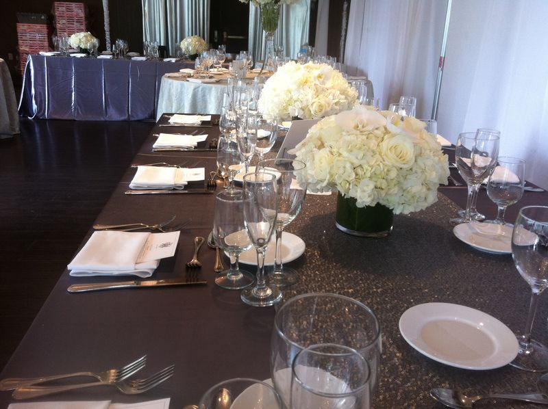 Long tables with two centerpieces low and lush wedding flowers by blank slate events nyc floral designer