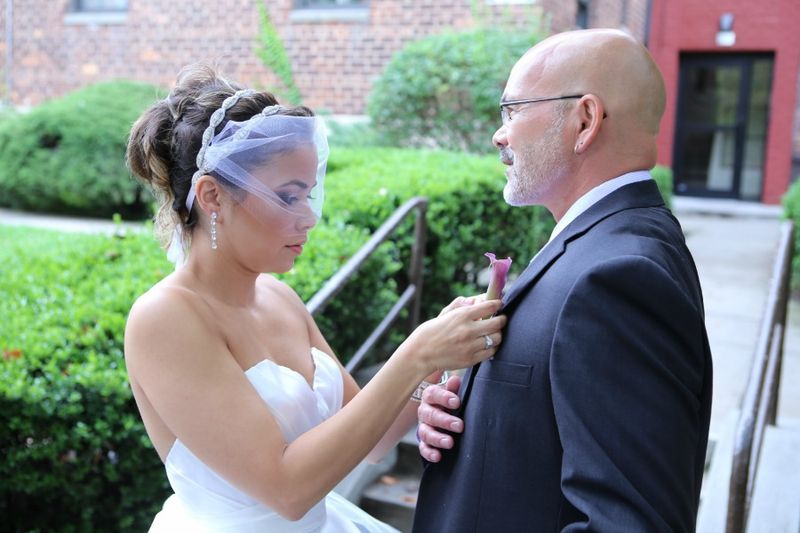 The bride pinning her fathers lavender calla lily boutonniere flowers by blank slate events nyc floral designer photo by Jerritt Clark Photography