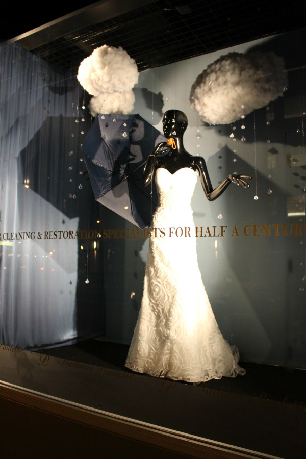 Blank Slate Events Designer Wedding Window Display at Madame Paulette Couture Cleaner and Restoration in NYC Rainy Day Window