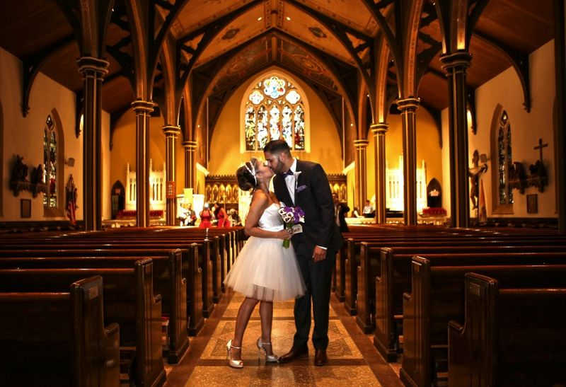 The married couple in church st charles borromeo church in brooklyn photo by Jerritt Clark Photography
